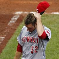 Photo - Cincinnati Reds relief pitcher Tony Cingrani (52) walks to the dugout after pitching the 11th inning of a baseball game against the Pittsburgh Pirates in Pittsburgh Thursday, June 19, 2014. The Pirates won 4-3. (AP Photo/Gene J. Puskar)