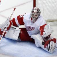 Photo - Detroit Red Wings goalie Jimmy Howard stops a shot during the first period in Game 7 of their first-round NHL hockey Stanley Cup playoff series against the Anaheim Ducks in Anaheim, Calif., Sunday, May 12, 2013. (AP Photo/Chris Carlson)