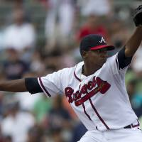 Photo - Atlanta Braves pitcher Julio Teheran delivers a pitch during the first inning of an exhibition spring training baseball game against the Houston Astros on Saturday, March 23, 2013, in Kissimmee, Fla.  (AP Photo/Evan Vucci)