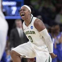 Photo - Baylor guard Odyssey Sims celebrates a basket against Kentucky during the first half of a regional semifinal in the NCAA college basketball tournament at the Purcell Pavilion in South Bend, Ind., Saturday, March 29, 2014.  (AP Photo/Paul Sancya)
