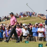 Photo - Phil Mickelson of the US plays his shot off the 9th tee box as Ernie Els of South Africa starts to walk along the fairway during the second day of the British Open Golf championship at the Royal Liverpool golf club, Hoylake, England, Friday July 18, 2014. (AP Photo/Scott Heppell)