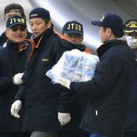 Photo - An official carries a main battery that was removed off an electrical room beneath the cockpit of an All Nippon Airways 787 at Takamatsu airport in Takamatsu, western Japan, Thursday, Jan. 17, 2013. The battery forced to make the emergency at the airport was swollen from overheating, a safety official said Thursday, as India and Europe joined the U.S. and Japan in grounding the technologically advanced aircraft because of fire risk. (AP Photo/Kyodo News)  JAPAN OUT, MANDATORY CREDIT, NO LICENSING IN CHINA, HONG KONG, JAPAN, SOUTH KOREA AND FRANCE