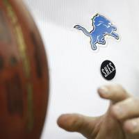 Photo - A Sandy Hook Elementary School pin is worn by a Detroit Lions assistant coach before the Lions' NFL football game against the Atlanta Falcons at Ford Field in Detroit, Saturday, Dec. 22, 2012. (AP Photo/Carlos Osorio)