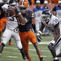 Photo -   Syracuse's Alec Lemon steps into the end zone for a touchdown against Connecticut during the third quarter of an NCAA college football game in Syracuse, N.Y., Friday, Oct. 19, 2012. At right is Connecticut safety Ty-Meer Brown. Syracuse won 40-10. (AP Photo/Kevin Rivoli)