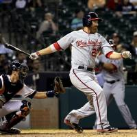 Photo - Washington Nationals' Adam LaRoche (25) watches a single that scored Denard Span during the ninth inning of a baseball game, in front of Houston Astros catcher Jason Castro on Tuesday, April 29, 2014, in Houston. (AP Photo/David J. Phillip)