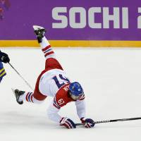 Photo - Czech Republic forward Michael Frolik, right, trips against Sweden forward Gabriel Landeskog in the third period of a men's ice hockey game at the 2014 Winter Olympics, Wednesday, Feb. 12, 2014, in Sochi, Russia. Sweden won 4-2.(AP Photo/Julio Cortez)