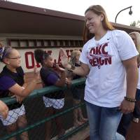 Photo - Oklahoma's Keilani Ricketts (10) greets fans at a celebration of their Women's College World Series title in Norman, Okla.,Friday, June 7, 2013. Photo by Sarah Phipps, The Oklahoman