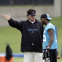 Photo -   Carolina Panthers' Joe Adams, right, listens to special teams coach Brian Murphy, left, during the NFL football team's minicamp practice for rookies and free agents in Charlotte, N.C., Saturday, May 12, 2012. (AP Photo/Chuck Burton)