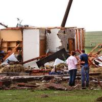 Photo - TORNADO / DAMAGE / AFTERMATH / HOUSE / STATE HIGHWAY 74: Kiley Witte, 34, far right, is comforted by a  woman as they look at what remains  of his home on SH 74 east of Cashion after a tornado destroyed it  Tuesday afternoon,  May 24, 2011,   Witte and his dog were in a storm cellar in his front yard.  His wife and young son had done to Oklahoma City and were in a safe room of a business where she works.  Photo by Jim Beckel, The Oklahoman ORG XMIT: KOD