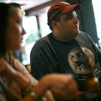 Photo - Robert Brauman (right) and Rhonda Goolsby (left) talk with other members of Texas A&M Club of Oklahoma City, during a meeting at RedPin Restaurant and Bowling Lounge in Oklahoma City on Wednesday, Aug. 24, 2011. Photo by John Clanton, The Oklahoman ORG XMIT: KOD