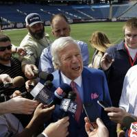 Photo - New England Patriots owner Robert Kraft, center, speaks with reporters on the NFL football field at Gillette Stadium in Foxborough, Mass., Thursday, May 2, 2013. (AP Photo/Steven Senne)