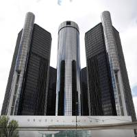 Photo - This Friday, May 16 2014 photo shows General Motors' world headquarters in Detroit. U.S. safety regulators fined General Motors a record $35 million Friday for taking at least a decade to disclose defects with ignition switches in small cars that are now linked to at least 13 deaths. (AP Photo/Paul Sancya)