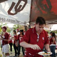 Photo - Bryan Cindell, Frisco, Texas, tailgates across from the stadium before a college football game between the University of Oklahoma Sooners (OU) and the Kansas State University Wildcats (KSU) at Gaylord Family-Oklahoma Memorial Stadium, Saturday, September 22, 2012. Photo by Steve Sisney, The Oklahoman