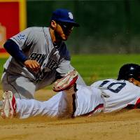 Photo - Chicago White Sox' Alexei Ramirez steals second base against San Diego Padres' Alexi Amirista during the fourth inning of a baseball game on Saturday, May 31, 2014, in Chicago. (AP Photo/Matt Marton)