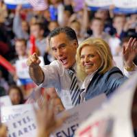 Photo -   Republican presidential candidate and former Massachusetts Gov. Mitt Romney with his wife Ann greet supporters during a campaign rally at the International Exhibition Center in Cleveland, Sunday Nov. 4, 2012. (AP Photo/Jerome Delay)