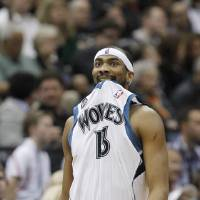Photo - Minnesota Timberwolves forward Corey Brewer walks downcourt as a teammate shoots a free throw during the second quarter of an NBA basketball game against the Houston Rockets in Minneapolis, Friday, April 11, 2014. (AP Photo/Ann Heisenfelt)