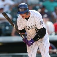 Photo - Colorado Rockies' Troy Tulowtizki reacts after striking out with two runners on base, against the St. Louis Cardinals in the ninth inning of the Cardinals' 9-6 victory in a baseball game in Denver on Wednesday, June 25, 2014. (AP Photo/David Zalubowski)