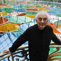 Photo -   Contemporary artist Daniel Buren poses in the Grand Palais during the opening of ground-breaking Monumenta exhibit in Paris, Wednesday May 9, 2012. Monumenta, the hugely-popular annual installation project that's in its fifth year, dares an artist of international statue to