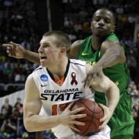 Photo - OSU's Phil Forte under pressure from Oregon's Johnathan Loyd in the second round of the NCAA Basketball tournament in San Jose, CA, Mar. 21, 2013. STEPHEN PINGRY/Tulsa World