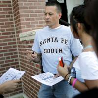 Photo - Superintendent Chris Brewster talks with students during the August 2011 Back 2 School Bash at Santa Fe South Charter High School. Oklahoman Archive photo