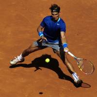 Photo - Spain's Rafael Nadal returns the ball to fellow countryman Albert Ramos during the Barcelona open tennis in Barcelona, Spain, Wednesday, April 23, 2014. (AP Photo/Manu Fernandez)