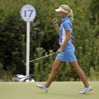 Photo - Europe's Anna Nordqvist, from Sweden, reacts after winning the 17th hole to tie United States' Stacy Lewis in their singles match at the Solheim Cup golf tournament on Sunday, Aug. 18, 2013, in Parker, Colo. (AP Photo/Chris Carlson)