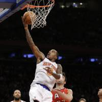Photo - New York Knicks guard J.R. Smith (8) goes up for a a layup in the second quarter of an NBA basketball game against the Atlanta Hawks at Madison Square Garden in New York, Sunday, Jan. 27, 2013.  (AP Photo/Kathy Willens)