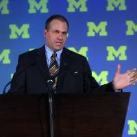 Photo - Rich Rodriguez, former head football coach at University of West Virginia, is introduced as the new University of Michigan football coach, Monday, Dec. 17, 2007, in Ann Arbor, Mich.  (AP Photo/Tony Ding)  ORG XMIT: MITD103