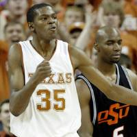 Photo - Texas' Kevin Durant (35) pumps his fist on his chest after a three-point play over Oklahoma State's Marcus Dove (5) during the second of the college basketball game between the Oklahoma State University (OSU) Cowboys and the University of Texas (UT) Longhorns at the Frank C. Erwin, Jr., Special Events Center on Monday, Feb. 12, 2007, in Austin, Texas.   staff photo by CHRIS LANDSBERGER  ORG XMIT: KOD