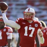 Photo - FILE - In this Nov. 29, 2013, file photo, Nebraska quarterback Ryker Fyfe (17) throws during warmups as Iowa and Nebraska prepare to square off in an NCAA college football game in Lincoln, Neb. Fyfe has used his underdog attitude to fuel his drive to the top backup quarterback's job behind Tommy Armstrong Jr. (AP Photo/Nati Harnik, File)