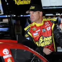 Photo -   Driver Clint Bowyer looks on from the garage area before practice for the AAA 400 NASCAR Sprint Cup Series auto race, Friday, Sept. 28, 2012, in Dover, Del. (AP Photo/Nick Wass)