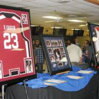 Photo - Silent auction items at Blake Griffin's Bowling Down Cancer Charity Event included Griffin's jersey from his basketball days at the University of Oklahoma. A live auction item -- dinner for 10 with Griffin -- went for $6,000. PHOTO BY LILLIE-BETH BRINKMAN, THE OKLAHOMAN