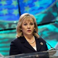 Photo - Gov. Mary Fallin discusses her plan to increase the availability of natural gas vehicles Wednesday during the 2011 Governor's Energy Conference at the Cox Convention Center.  Steve Maupin - For The Oklahoman