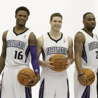 Photo - Sacramento Kings guards, from left, Ben McLemore, Jimmer Fredette and Marcus Thornton pose for photos during the team's NBA basketball media day in Sacramento, Calif., Monday, Sept. 30, 2013. (AP Photo/Rich Pedroncelli)