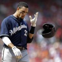 Photo - Milwaukee Brewers' Carlos Gomez tosses aside his batting helmet after popping out to end the top of the seventh inning of a baseball game against the St. Louis Cardinals Sunday, Aug. 3, 2014, in St. Louis. (AP Photo/Jeff Roberson)