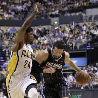 Photo -   Orlando Magic forward Hedo Turkoglu, right, drives on Indiana Pacers guard Paul George in the first half of Game 5 of an NBA basketball first-round playoff series, in Indianapolis on Tuesday, May 8, 2012. (AP Photo/Michael Conroy)
