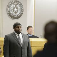 Photo - FILE - In this Jan. 10, 2014 file photo, former Dallas Cowboys' Josh Brent stands in court as potential jurors are directed into Judge Robert Burns', rear, courtroom in Dallas.  Brent's trial is expected to start Monday on allegations that he was driving drunk and caused the death of his friend, college teammate and former Dallas practice squad player Jerry Brown in a December 2012 crash. (AP Photo/LM Otero, File)