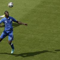 Photo - Italy's Mario Balotelli controls the ball during the group D World Cup soccer match between Italy and Costa Rica at the Arena Pernambuco in Recife, Brazil, Friday, June 20, 2014.  (AP Photo/Hassan Ammar)
