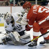 Photo - Dallas Stars goalie Kari Lehtonen (32), of Finland, stops a shot by Detroit Red Wings center Valtteri Filppula (51) during the second period of an NHL hockey game in Detroit, Tuesday, Jan. 29, 2013. (AP Photo/Paul Sancya)