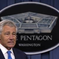 Photo - FILE - In this March 1, 2013 file photo, Defense Secretary Chuck Hagel arrives at a news conference at the Pentagon. A case involving an Air Force general who dismissed charges against a lieutenant colonel convicted of sexual assault will be reviewed at the top levels of the Pentagon, Defense Secretary Chuck Hagel said in a letter released Monday. But it seemed unlikely that the ruling would be changed. (AP Photo/Carolyn Kaster, File)