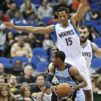 Photo -   Minnesota Timberwolves' Anthony Randolph (15) defends Memphis Grizzlies' Mike Conley during the first half of an NBA basketball game Tuesday, April 17, 2012, in Minneapolis. (AP Photo/Jim Mone)