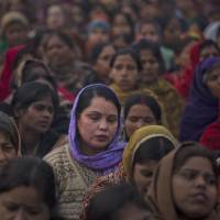Photo - Indian women offer prayers for a gang rape victim at Mahatma Gandhi memorial in New Delhi, India, Wednesday, Jan. 2, 2013. India's top court says it will decide whether to suspend lawmakers facing sexual assault charges as thousands of women gathered at the memorial to independence leader Mohandas K. Gandhi to demand stronger protection for their safety. (AP Photo/ Dar Yasin)