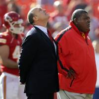 Photo - Kansas City Chiefs general manager Scott Pioli, left, and coach Romeo Crennel stand together before an NFL football game against the Carolina Panthers at Arrowhead Stadium in Kansas City, Mo., Sunday, Dec. 2, 2012. On Saturday, Kansas City Chiefs linebacker Jovan Belcher thanked Pioli and Belcher for giving him a chance in the NFL, before he turned away and fatally shot himself. (AP Photo/Ed Zurga)