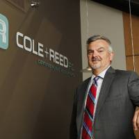 Photo - Jim Denny, managing partner at Cole & Reed, is seen Monday at the Cole & Reed offices in downtown Oklahoma City. Photo by Paul B. Southerland, The Oklahoman  PAUL B. SOUTHERLAND