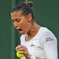 Photo - Flavia Pennetta of Italy shouts as she plays against Lauren Davis of the U.S. during their women's singles match at the All England Lawn Tennis Championships in Wimbledon, London, Wednesday, June 25, 2014. (AP Photo/Pavel Golovkin)