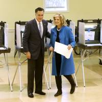 Photo -   Republican presidential candidate, former Massachusetts Gov. Mitt Romney and wife Ann Romney vote in Belmont, Mass., Tuesday, Nov. 6, 2012. (AP Photo/Charles Dharapak)