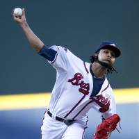 Photo - Atlanta Braves starting pitcher Ervin Santana (30) works in the first inning of a baseball game against the Los Angeles Dodgers  Wednesday, Aug. 13, 2014, in Atlanta. (AP Photo/John Bazemore)