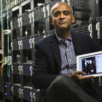 Photo - FILE - This Dec. 20, 2012 file photo shows Chet Kanojia, founder and CEO of Aereo, Inc., holding a tablet displaying his company's technology, in New York.  The Supreme Court has ruled that a startup Internet company has to pay broadcasters when it takes television programs from the airwaves and allows subscribers to watch them on smartphones and other portable devices. The justices said Wednesday by a 6-3 vote that Aereo Inc. is violating the broadcasters' copyrights by taking the signals for free. The ruling preserves the ability of the television networks to collect huge fees from cable and satellite systems that transmit their programming. (AP Photo/Bebeto Matthews, File)