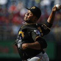 Photo - Pittsburgh Pirates starting pitcher Edinson Volquez throws during the first inning of a baseball game against the Washington Nationals, Sunday, Aug. 17, 2014, in Washington. (AP Photo/Alex Brandon)