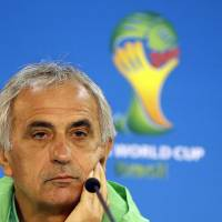 Photo - Algeria's head coach Vahid Halilhodzic listens during a press conference at the Estadio Beira-Rio Stadium in Porto Alegre, Brazil, Sunday, June 29, 2014.  Algeria will play Germany in a World Cup round of 16 soccer match on June 30. (AP Photo/Kirsty Wigglesworth)